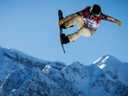 U.S. snowboarder Shaun White goes off a jump during snowboard slopestyle training at the 2014 Sochi