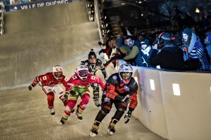 Dean Moriarity of Canada, Scott Croxall of Canada, Dylan Moriarity of Canada and Cameron Naasz of the United States compete during the finals of the first stage of the Ice Cross Downhill World Championship at the Red Bull Crashed Ice in Quebec City, Canada on November 28, 2015.