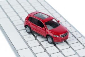 Auto auf Tastatur, Symbolfoto für Autokauf und Autohandel im Internet