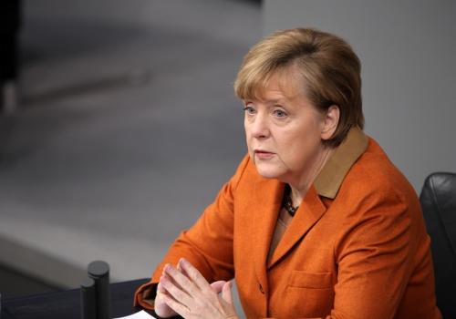 Angela Merkel schaut überrascht, über dts Nachrichtenagentur